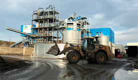 Treatment plant for sludge from contaminated soil